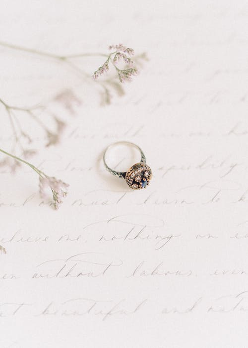 Gold and Silver Ring on White Snow