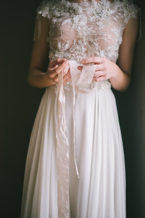 A Woman in White Floral Lace Dress