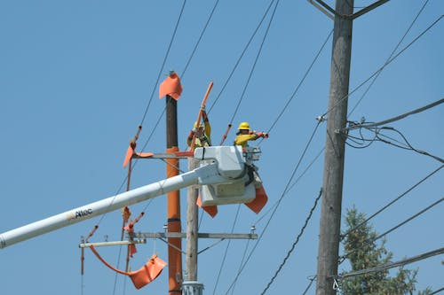 Free stock photo of Power Company, powerlines, utilities, utility workers