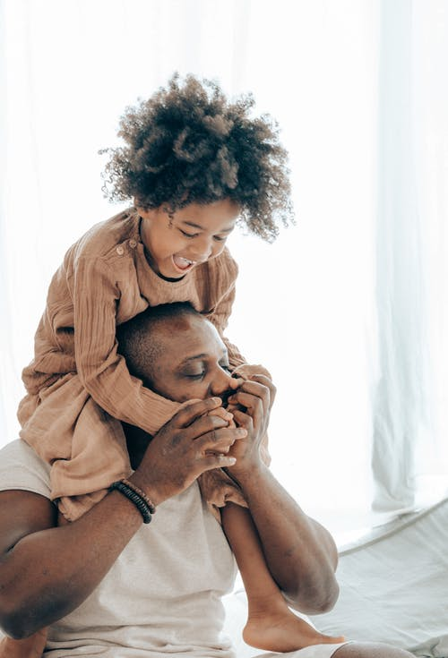 Black father and child having fun together