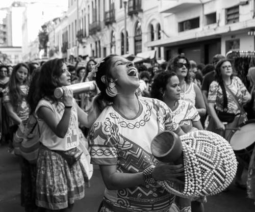 Crowd of ethnic women in traditional clothes at carnival