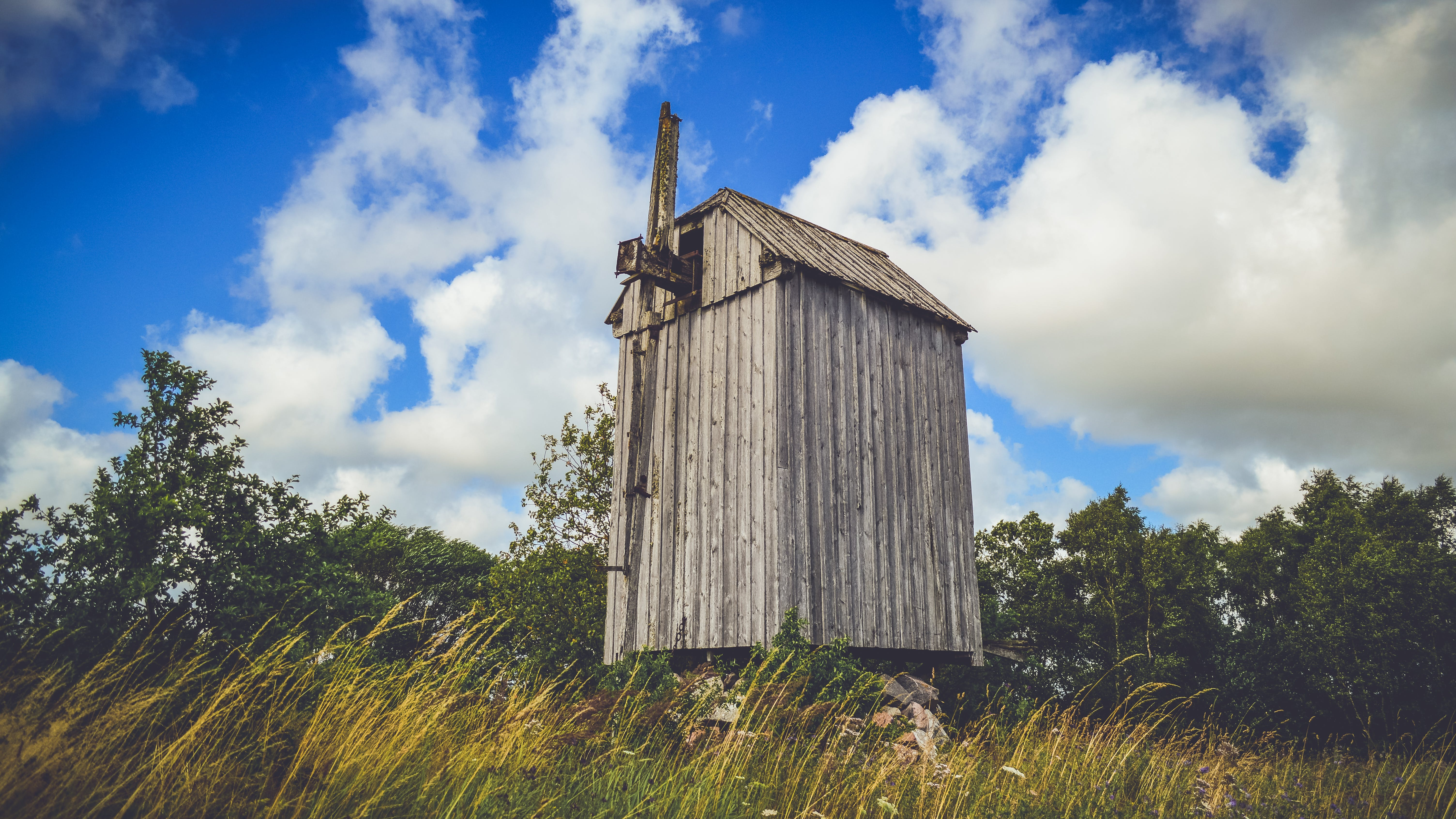 Brown Wooden Shed and Grass Field