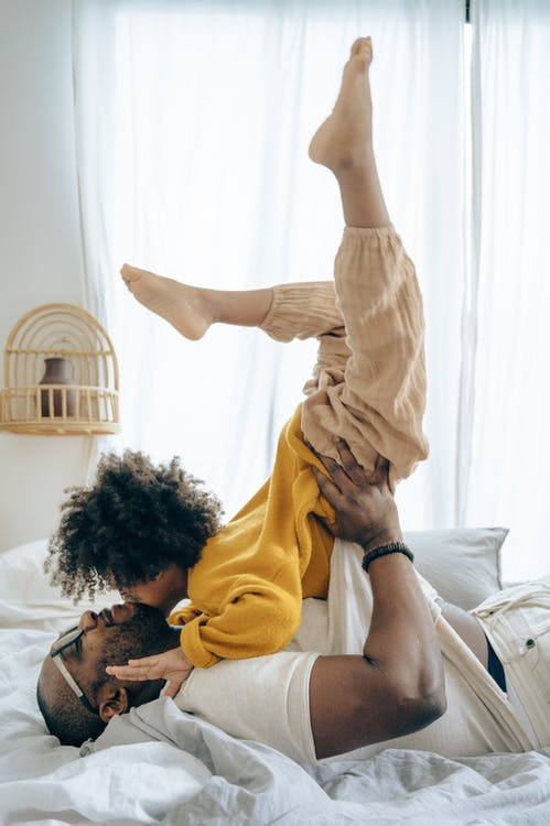 Man Playing With His Child