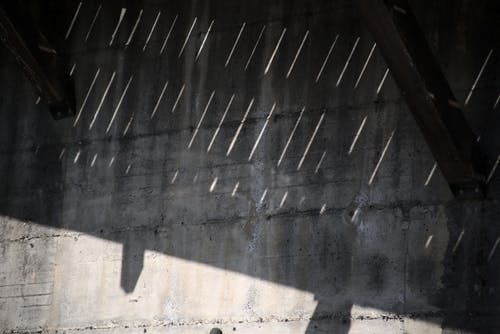 Shadow of roof on concrete wall
