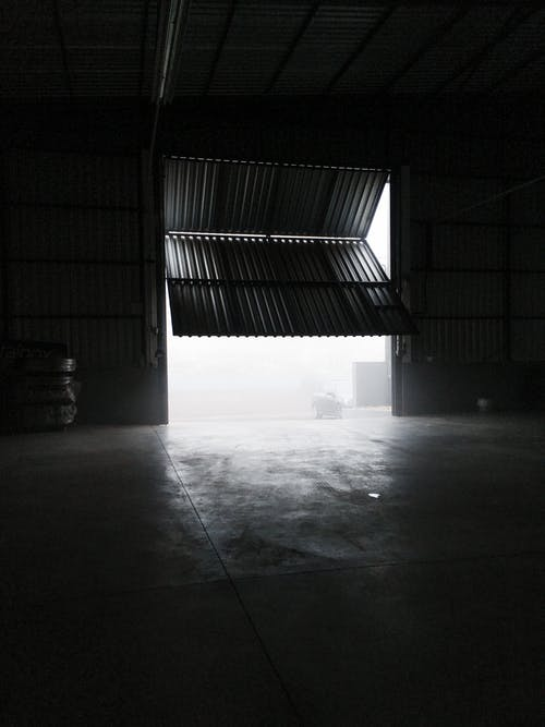Inside of spacious garage with metal panels