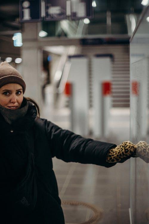 Woman in Black Jacket Wearing Knit Cap