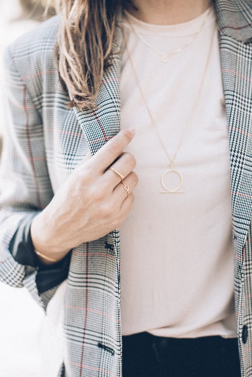 Person in White Button Up Shirt Wearing Gold Ring