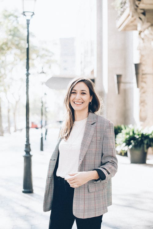 Woman in Gray Blazer Smiling