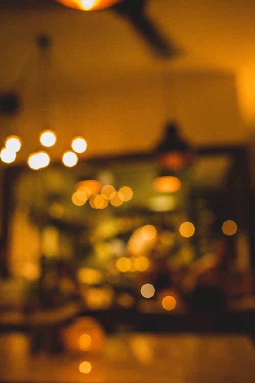 Blurred artificial illumination in cafe at night