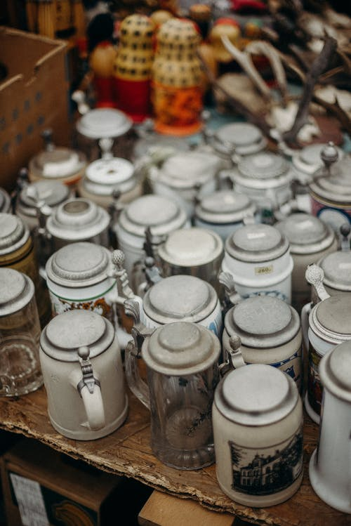 White Ceramic Jars on Brown Wooden Table