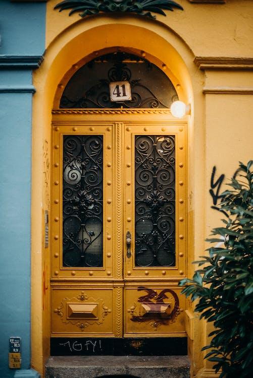 Blue Wooden Door With Black Steel Door Knob
