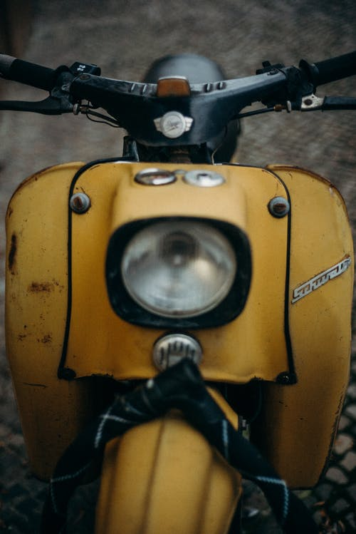 Yellow and Black Motorcycle With Black Handle Bar