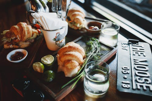 Delicious breakfast with assorted croissant sandwiches in cozy cafe