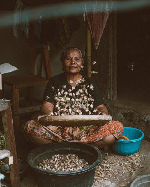 Ethnic senior female working in typical hut