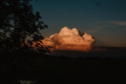 View from high mountain on huge cumulus cloud during amazing sunset in Rinjani National Park