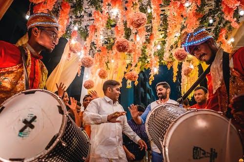 People Dancing with Drum Beats