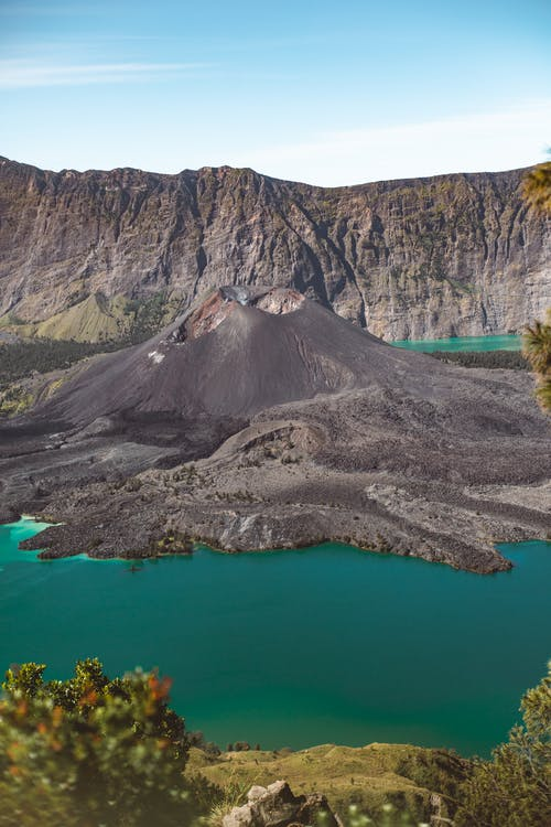 Wonderful scenery of mountains and volcano amidst blue water lake