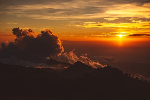 Amazing bright sunset over mountainous terrain