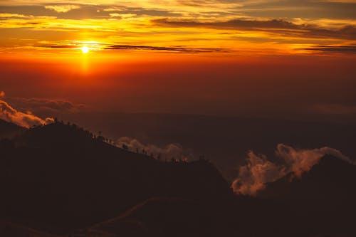 Mountain peaks in majestic sunset light