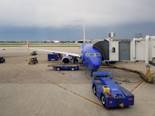 Grey sky above blue modern aircraft