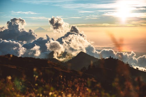 Cloudy sunset sky and hilly terrain