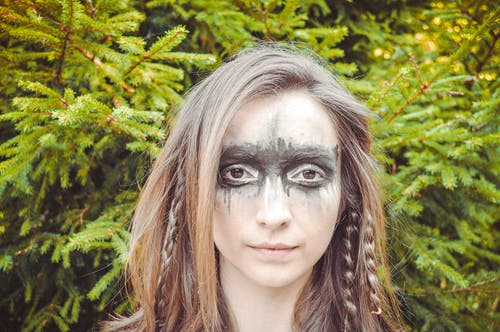 Young woman with greasepaint on face