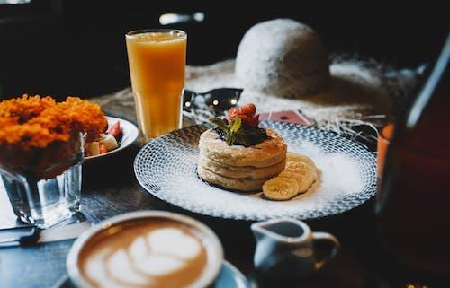 Tasty breakfast with dessert on table