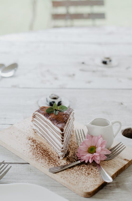 Yummy layer cake on wooden board