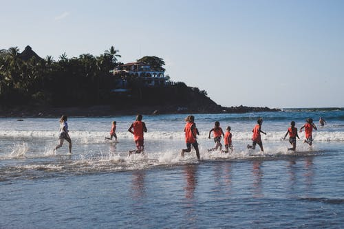 People running on seashore during training