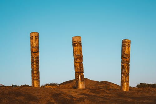Ancient wooden pagan statues in dry plain