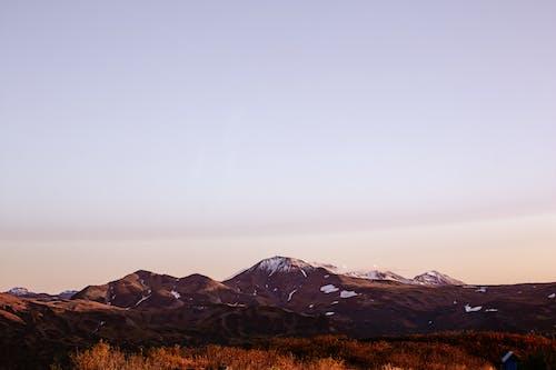 Mountain landscape against sunset sky