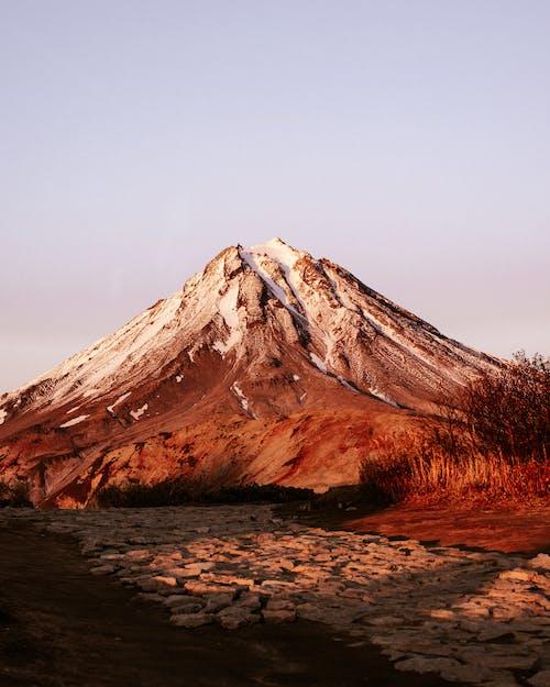 Snowy mountain peak against clear sky