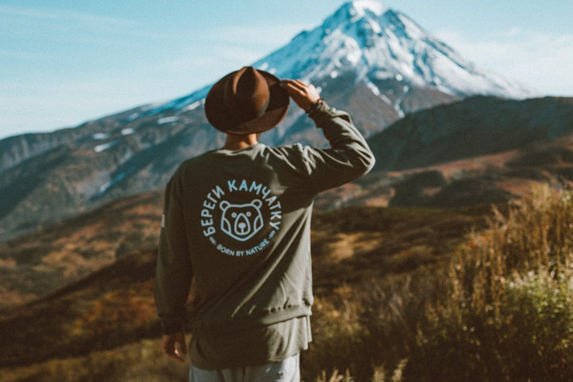 Lonely man in hat admiring picturesque view
