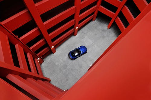 Blue Car Toy on Floor