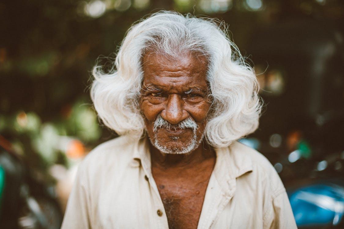 Optimist elderly ethnic man on urban street