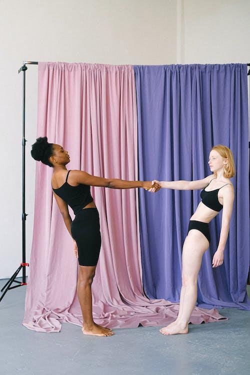 Interracial Women Balancing with Hands