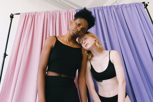 Interracial Women Leaning on Each Other