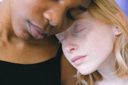 Heads of Interracial Women Leaning on Each Other