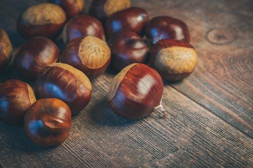 Brown Round Fruit on Gray Textile