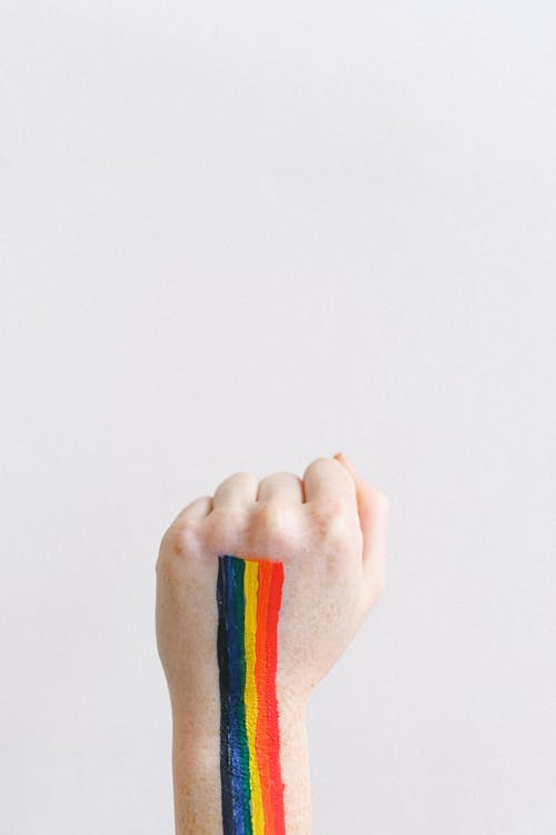 Fist with a Gay Pride Body Paint