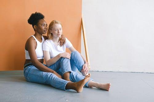 Women Sitting on Floor