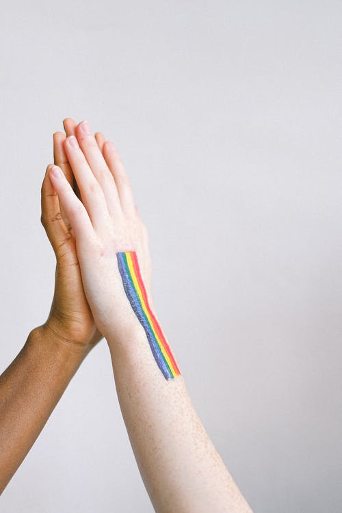 Hand With Gay Pride Body Paint giving a High Five
