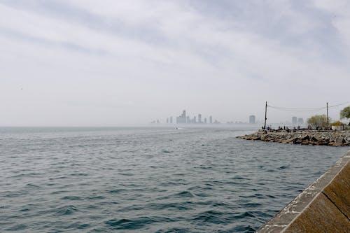 Бесплатное стоковое фото с вода, гавань, город, закат
