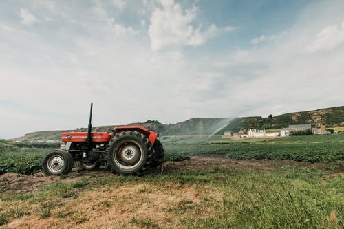 Tractor plowing soil in countryside in daytime