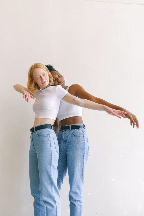 Women With Arms Outstretched