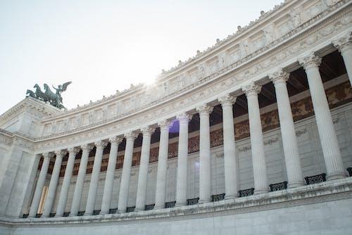 From below of majestic columns of Altare della Patria in Rome on sunny day