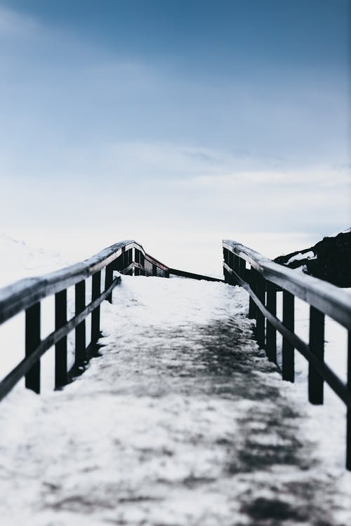 Frozen path in snowy valley in winter