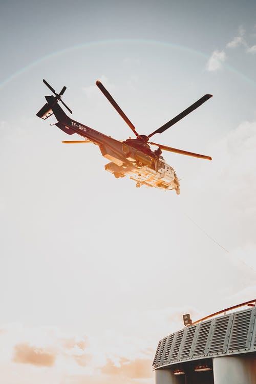 Helicopter in sky over construction