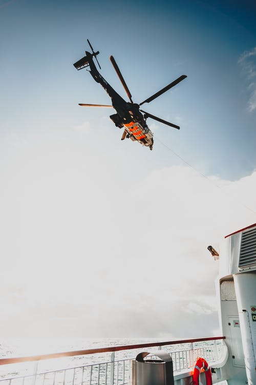 Helicopter in sky over ship
