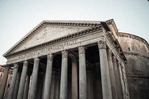From below of antique Rome Pantheon portico with granite Corinthian columns and Latin inscription on facade